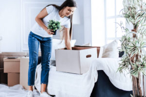 woman packing plants in spring